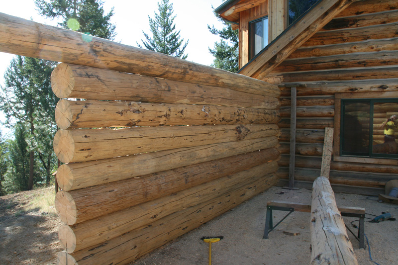 Log home kits for additions on your log cabin for Building onto a house